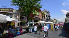 Buenos Aires Argentina La Boca colorful street and buildings for tourists with - stock footage