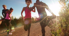 Young African-descent couple warming up before jogging outdoors - stock footage