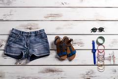 Woman's stylish shorts and footwear. Stock Photos