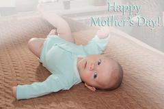 Cute four month baby boy mother's day concept - stock photo