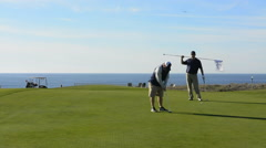 Half Moon Bay California Ritz Hotel  Golf Course golfers putting at Half Moon Stock Footage