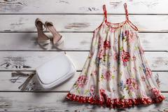 Floral sarafan and footwear. Stock Photos