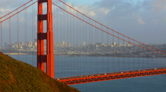San Francisco California Golden Gate Bridge with city on water from cliff on Stock Footage