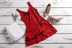 Clothes and footwear on table. - stock photo