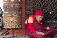 Pilgrim at Boudhanath Stupa in Kathmandu, Nepal - stock photo