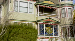 Petaluma California old Victorian home with stained glass and green colors - stock footage