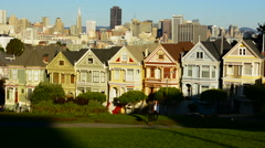 San Francisco California Painted Ladies Victorian homes and city in background Stock Footage