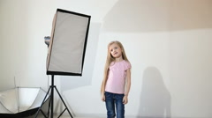 Photographer taking pictures of the child in the studio Stock Footage