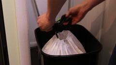 Man takes out kitchen trash - stock footage