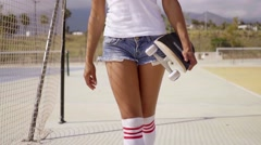 Lower front half of female skater wearing shorts Stock Footage