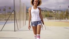 Beautiful afro female skater wearing shorts Stock Footage