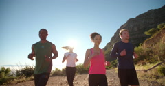 Multi-ethnic group of athletes running on a footpath - stock footage