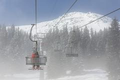 Ski lift in the fog Stock Photos