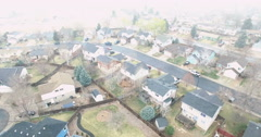 Aerial view of residential neighborhood at the beginning of snow storm. - stock footage