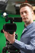 Male Camera Operator In Television Studio - stock photo