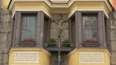 Sculpture of crucified Jesus on a building in Innsbruck Stock Footage