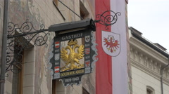 Close view of Gasthof Goldener Adler sign in Innsbruck Stock Footage
