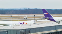 Business Jet Passing Fedex Cargo Terminal at Washington Dulles Airport Stock Footage
