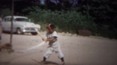 1964: Boy little league baseball strikeout swings at pitches in dirt. - stock footage