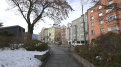 Cars driving and parked bikes on Innstrasse, Innsbruck Stock Footage