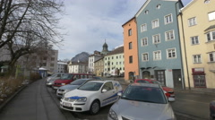 Cars parked in front of the colorful houses on Innerstrasse, Innsbruck Stock Footage