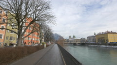 Leafless trees and colorful buildings on Inn riverside, Innsbruck Stock Footage