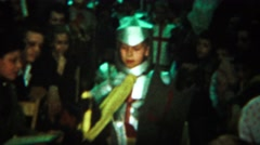 Stock Video Footage of 1964: Boy wearing knight costume crowd watching walk down aisle.