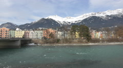 Brightly coloured houses along the river in Innsbruck Stock Footage