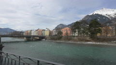 View of a bridge over Inn River and the riverside buildings, Innsbruck Stock Footage