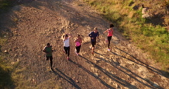 Athletic friends involved in an outdoors running training Stock Footage