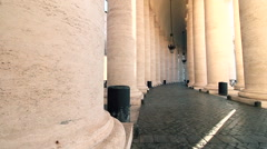 Inside bernini colonnade in saint peter square dolly camera Stock Footage