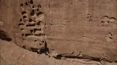 Panning Aerial Shot of Rock Climber near Moab, Utah - stock footage