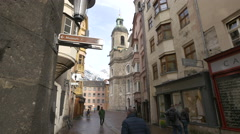 People walking on Pfarrgasse close to Saint Jacob Cathedral, Innsbruck - stock footage