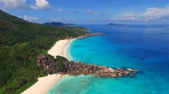 Aerial view of beach with white sand and crystal clear azure water, Seychelles Stock Footage