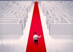 Smart businessman avoiding maze concept - stock photo