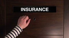 Woman knocking on insurance agent office door Stock Footage