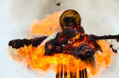 Burning down scarecrow of Shrovetide Stock Photos