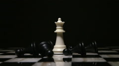 Chess White Queen Surrounded by Fallen Black Pawns 3 Stock Footage