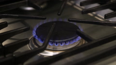 Stovetop burner turned on low Stock Footage