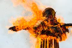 Burning down effigy of Shrovetide Stock Photos