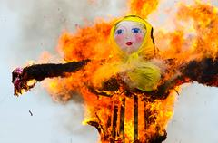 Burning of scarecrow of Shrovetide Stock Photos