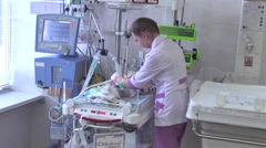 Newborn babies after heart surgery at reanimation section Stock Footage