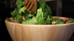 Pans of salad being tossed Stock Footage
