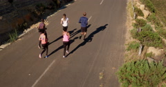 Group of athletes giving high five after a run Stock Footage
