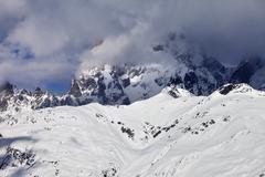 Mount Ushba in haze at sunny day - stock photo