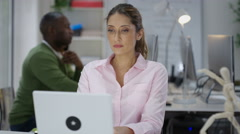 4K Mature student or casual businesswoman looking at something on computer Stock Footage