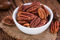 Heap of Pecan Nuts (selective focus) Stock Photos