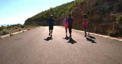 Group of mutli-ethnical athletes running outdoors Stock Footage