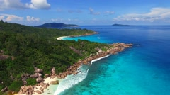 Aerial view of tropical coast with white sand and azure sea water, Seychelles Stock Footage
