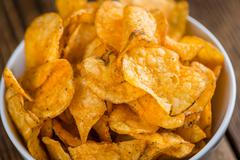 Heap of Chilli Potato Chips (selective focus) Stock Photos
